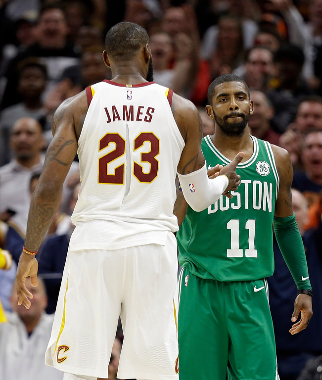 . Cleveland Cavaliers\' LeBron James and Boston Celtics\' Kyrie Irving, right, shake hands after the Cavaliers defeated the Celtics in the second half of an NBA basketball game, Tuesday, Oct. 17, 2017, in Cleveland. The Cavaliers won 102-99. (AP Photo/Tony Dejak)