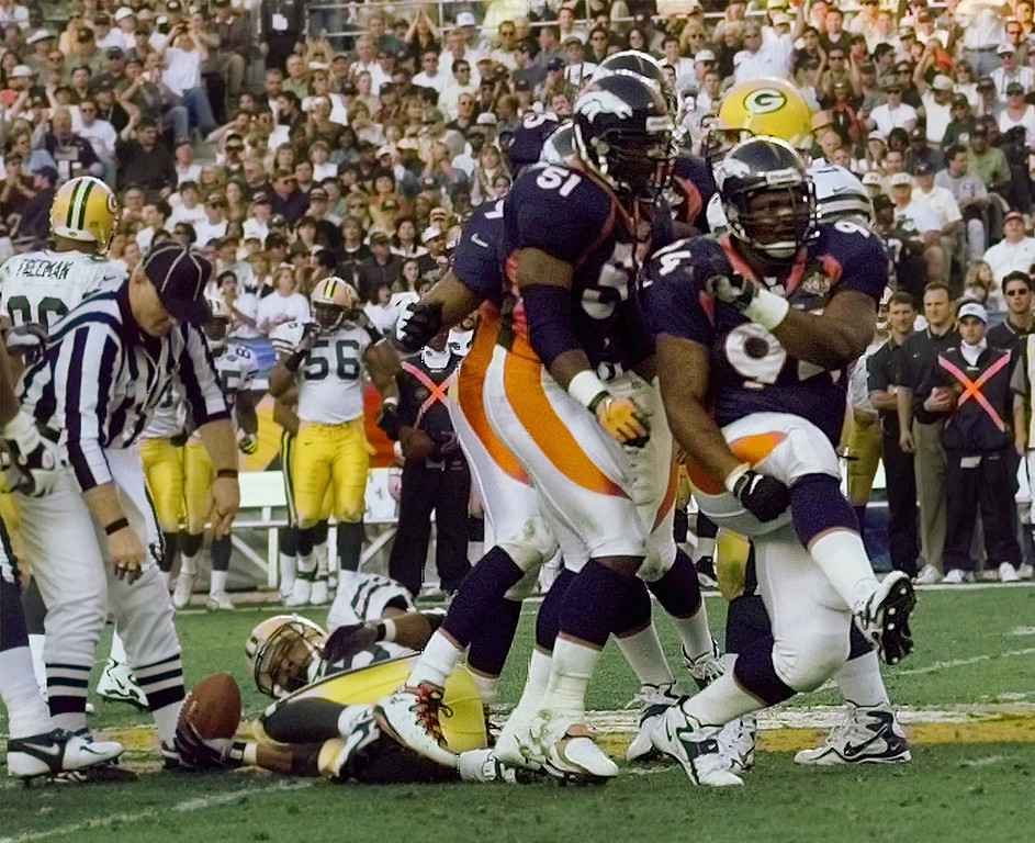 . Denver Broncos defenders Keith Traylor (94) and Jon Hesse (51) celebrate after stopping Green Bay Packers\' Dorsey Levens, on ground, at Super Bowl XXXII in San Diego\'s Qualcomm Stadium Sunday, Jan. 25, 1998. (AP Photo/John Gaps III)