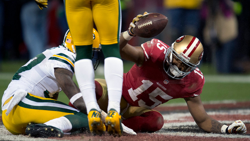 Description of . San Francisco 49ers wide receiver Michael Crabtree (15) scores his second touchdown in the second quarter against the Green Bay Packers during an NFC divisional playoff NFL football game on Saturday, Jan. 12, 2013, in San Francisco. (AP Photo/The Sacramento Bee, Paul Kitagaki Jr.)