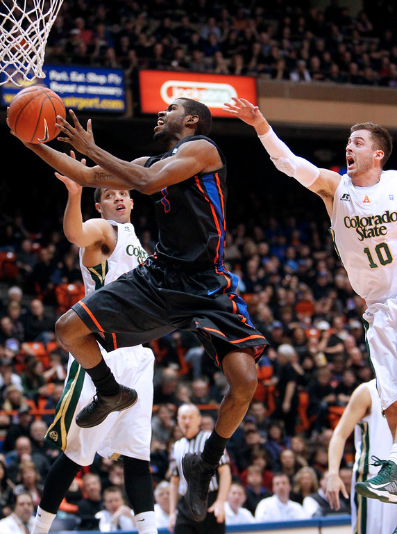 . Boise State guard Michael Thompson (1) drives between Colorado State defenders Wes Eikmeier (10) and Daniel Bejarano (2) during an NCAA college basketball game in Boise, Idaho, Saturday, March 2, 2013.  (AP Photo/Darin Oswald)