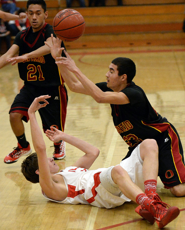 . Pasadena\'s Edin Memisevic, left, scrambles for the ball with Ontario\'s Alfonso Bueno (23) in the first half of a prep playoff game at Pasadena High School in Pasadena, Calif., on Friday, Feb.21, 2014. (Keith Birmingham Pasadena Star-News)
