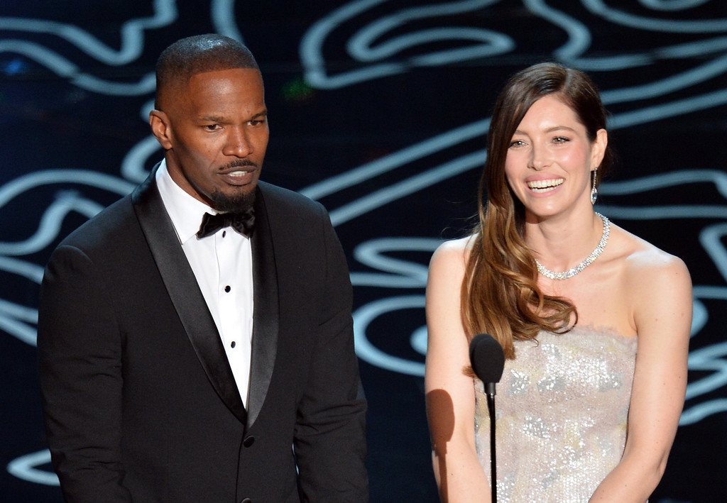 . Actors Jamie Foxx and Jessica Biel speak onstage during the Oscars at the Dolby Theatre on March 2, 2014 in Hollywood, California.  (Photo by Kevin Winter/Getty Images)