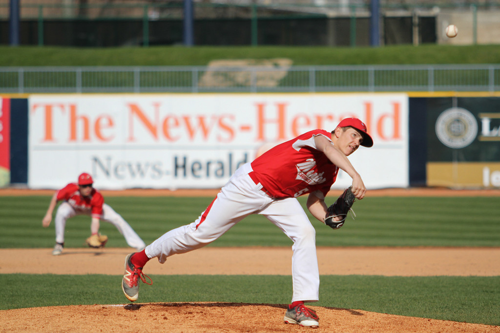 . Michael Johnson - The News-Herald Mentor pitcher, Jeremy McClure, throws a curveball during the Mentor vs. Ignatius Baseball game at Classic Park on April 20, 2016.  Ignatius defeated Mentor 5-4.