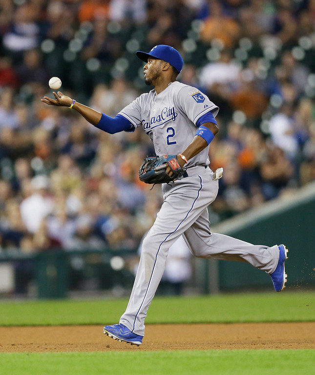. Kansas City Royals shortstop Alcides Escobar bobbles a single by Detroit Tigers\' Andrew Romine during the eighth inning of a baseball game in Detroit, Tuesday, Sept. 9, 2014. (AP Photo/Carlos Osorio)
