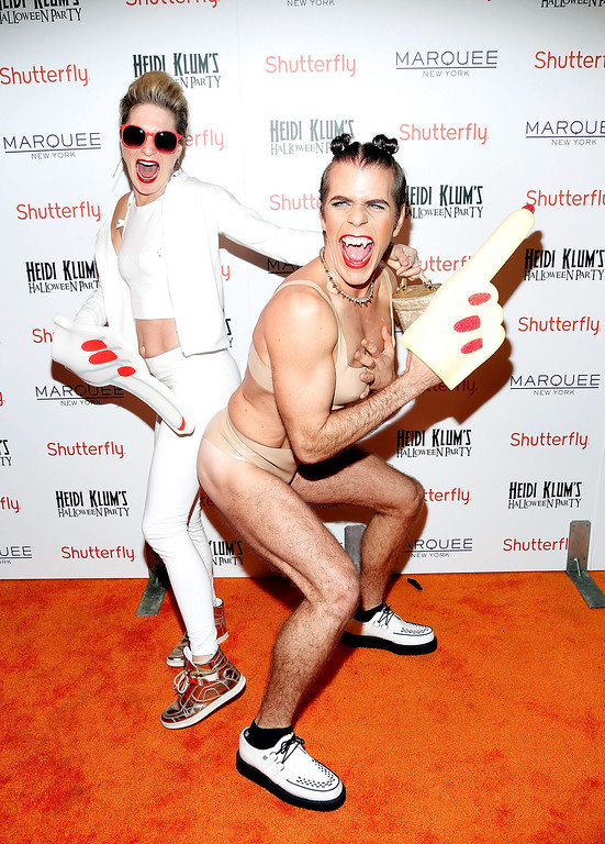 . Julie Macklowe (L) and Perez Hilton attend Shutterfly Presents Heidi Klum\'s 14th Annual Halloween Party sponsored by SVEDKA Vodka and smartwater at Marquee on October 31, 2013 in New York City.  (Photo by Cindy Ord/Getty Images for Heidi Klum)
