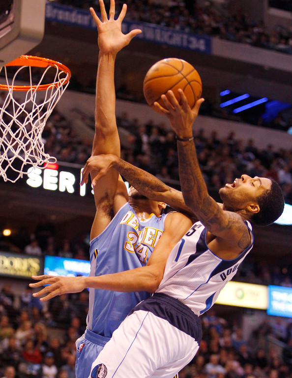 . The Denver Nuggets\' JaVale McGee fouls the Dallas Mavericks\' Chris Douglas-Roberts, right, at the American Airlines Center in Dallas, Texas, on Friday, December 28, 2012. (Richard W. Rodriguez/Fort Worth Star-Telegram/MCT)