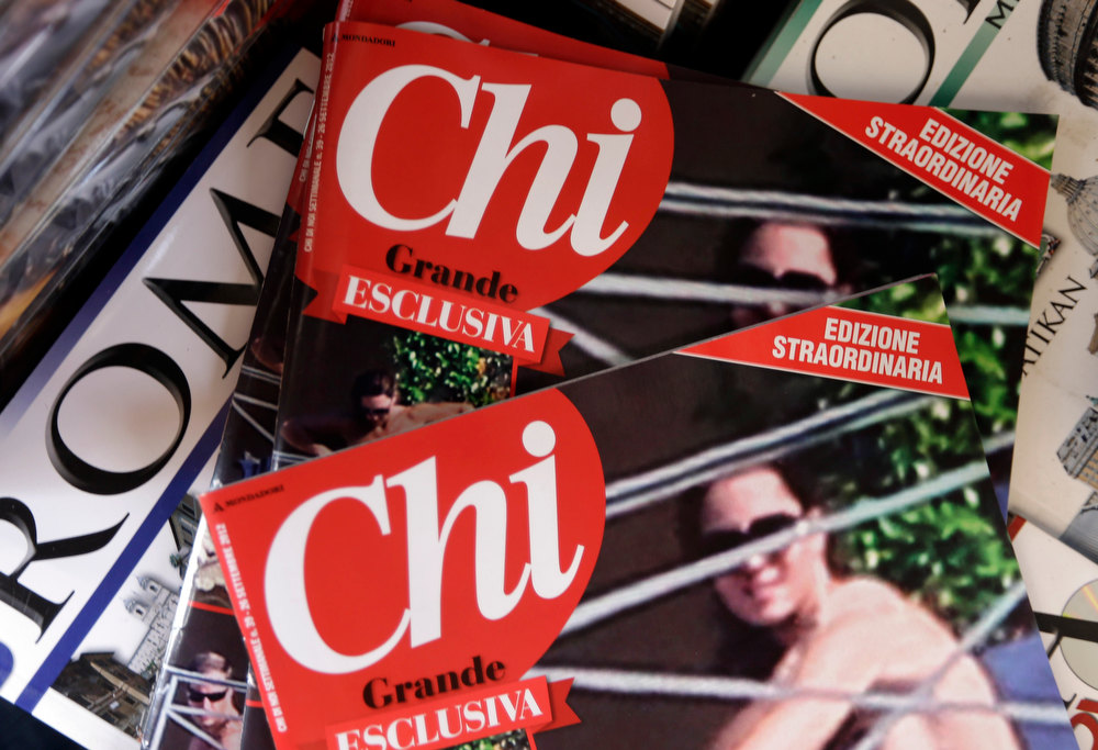 ". Copies of the Italian magazine Chi are displayed at a newstands in Rome, Monday, Sept. 17, 2012. An Italian gossip magazine owned by former Premier Silvio Berlusconi published a 26-page spread of topless photos of Prince William\'s wife Kate on Monday despite legal action in France against the French magazine that published them first. Chi hit newsstands on Monday, featuring a montage of photos taken while the Duke and Duchess of Cambridge were on vacation at a relative\'s home in the south of France last month. They included the 14 pictures published by the popular French magazine Closer, which like Chi is owned by Berlusconi\'s Mondadori publishing house. ""Kate Middleton Pictures Released\"" ranked as Google\'s second most searched trending event of 2012. \""Kate Middleton\"" ranked sixth in searches overall. (AP Photo/Alessandra Tarantino)"