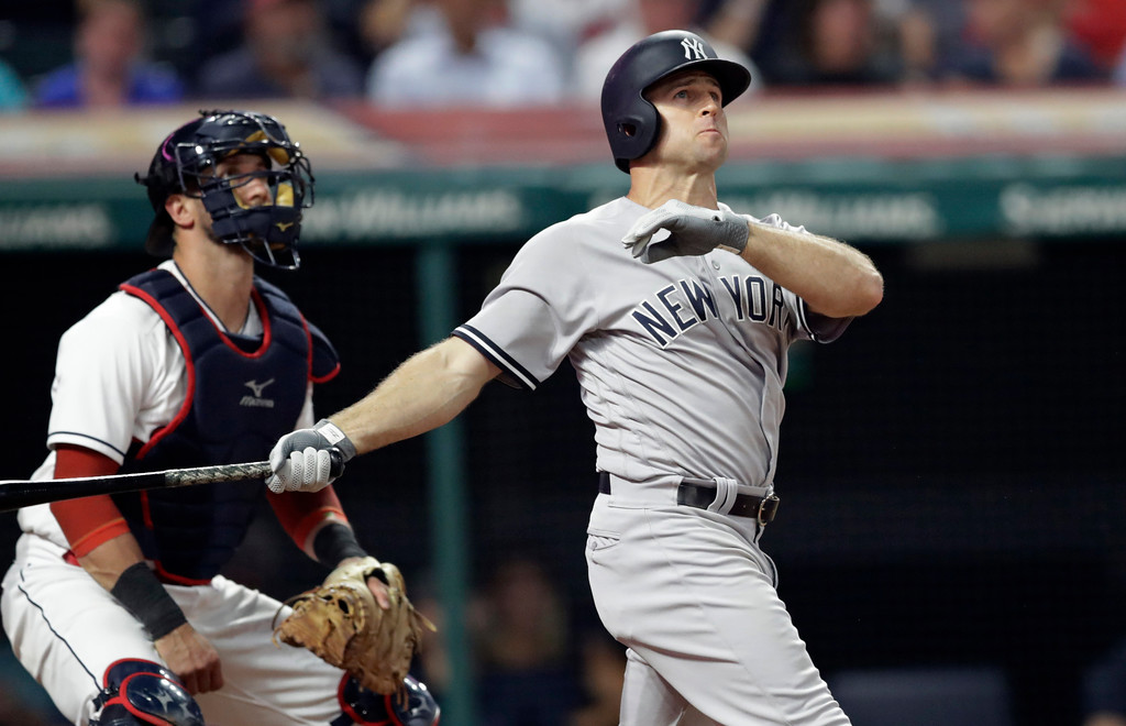 . New York Yankees\' Brett Gardner watches his solo home run in the ninth inning of the team\'s baseball game against the Cleveland Indians, Thursday, July 12, 2018, in Cleveland. Indians catcher Yan Gomes is at left. The Yankees won 7-4. (AP Photo/Tony Dejak)