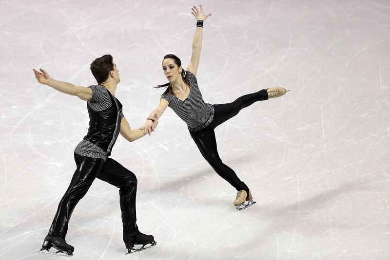 . Nicole Della Monica and Matteo Guarise of Italy skate their short program in the pairs competition at the 2013 World Figure Skating Championships in London, Ontario, March 13, 2013.    GEOFF ROBINS/AFP/Getty Images