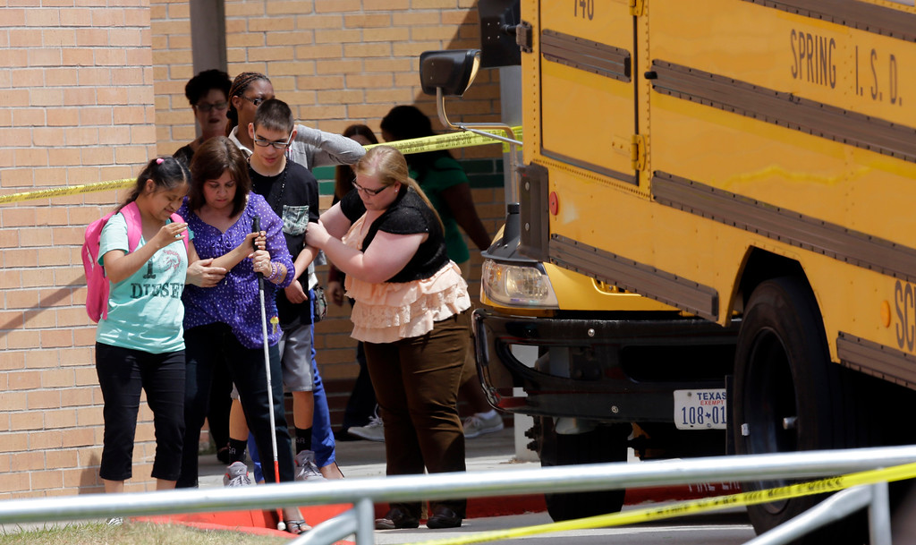 . Students are loaded onto a bus outside Spring High School Wednesday, Sept. 4, 2013, in Spring, Texas.  (AP Photo/David J. Phillip)