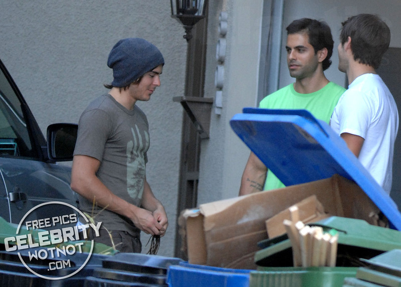 EXCLUSIVE: Zac Efron Helps Fashions Beanie And Wears Low Riding Jeans!