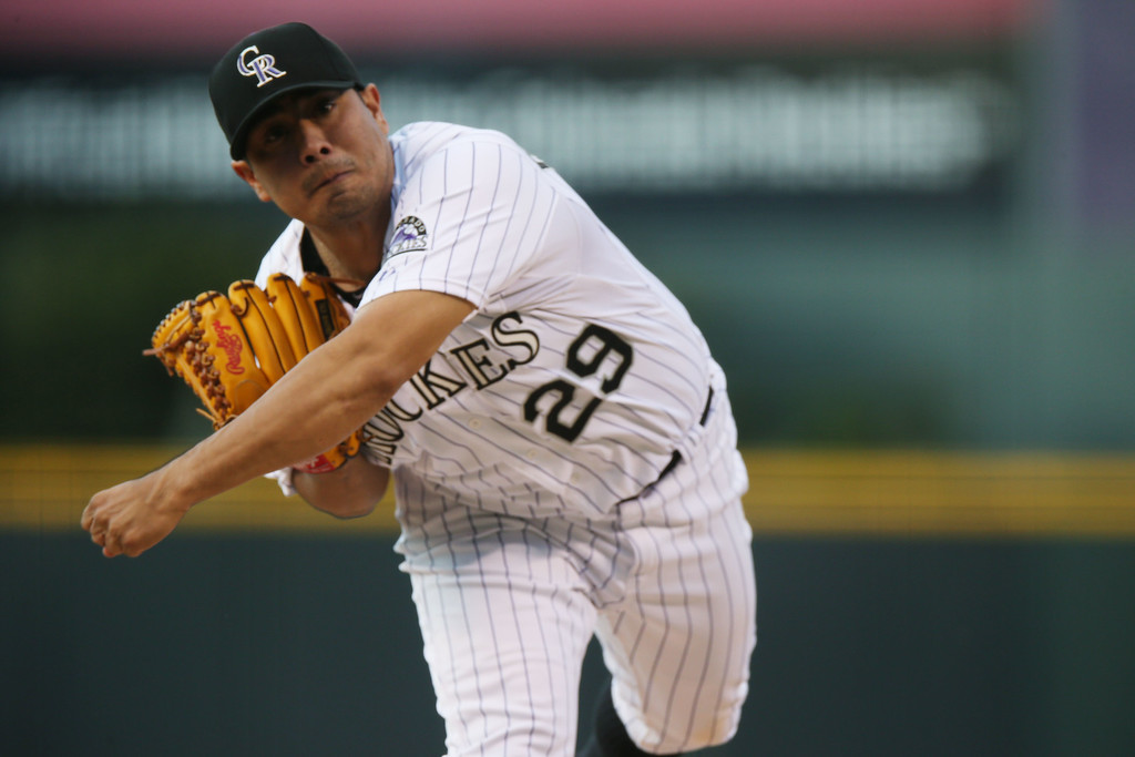 . Colorado Rockies starting pitcher Jorge De La Rosa works against the San Diego Padres in the first inning of a baseball game in Denver on Saturday, Sept. 6, 2014. (AP Photo/David Zalubowski)