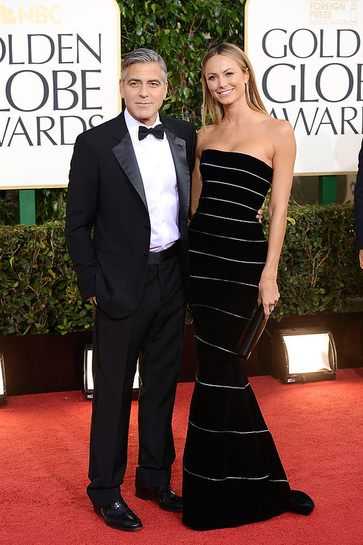 . Actor George Clooney (L) and actress Stacy Keibler arrive at the 70th Annual Golden Globe Awards held at The Beverly Hilton Hotel on January 13, 2013 in Beverly Hills, California.  (Photo by Jason Merritt/Getty Images)