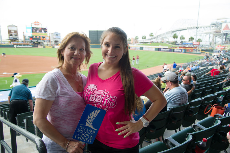 An islander student and her mother( alumni) at Whatabuger field Almuni Night at the Hooks.