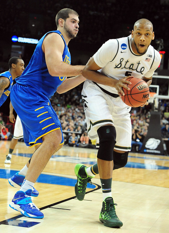 . Adreian Payne #5 of the Michigan State Spartans tries to post up on Carl Baptiste #33 of the Delaware Fightin Blue Hens during the second round of the 2014 NCAA Men\'s Basketball Tournament at Spokane Veterans Memorial Arena on March 20, 2014 in Spokane, Washington.  (Photo by Steve Dykes/Getty Images)
