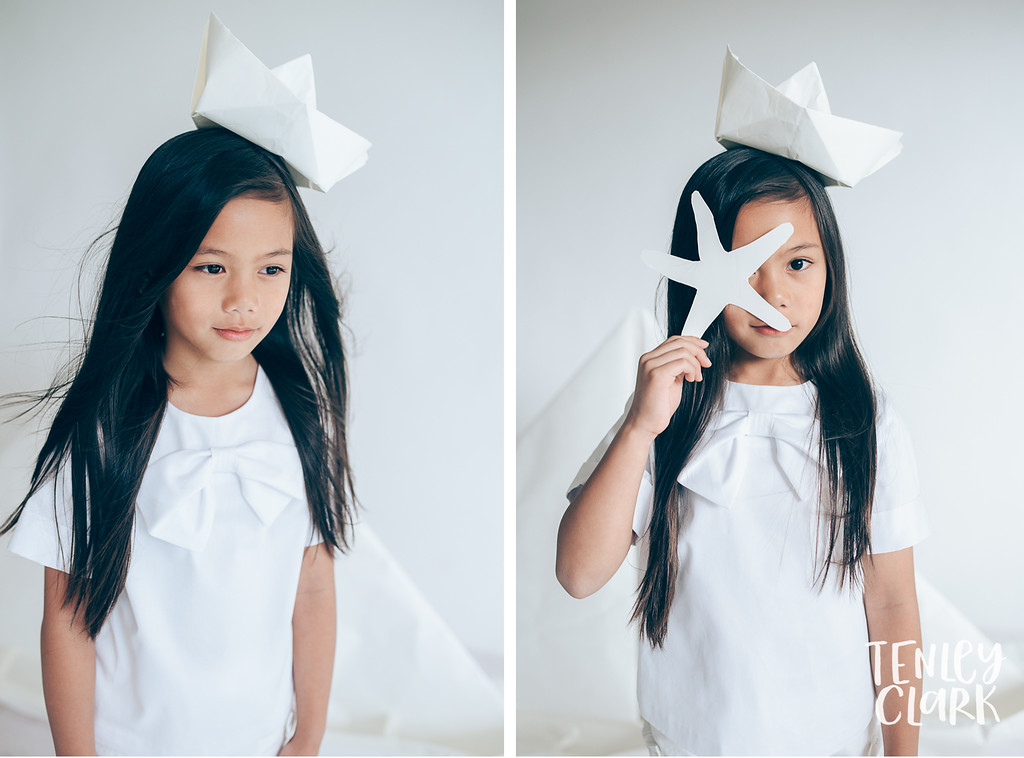 Little sailor girl. Whimsical kid's fashion editorial with giant white paper origami props. Photography by Tenley Clark.