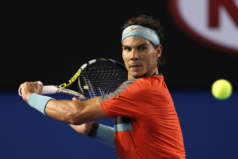 . Rafael Nadal of Spain plays a backhand in his semifinal match against Roger Federer of Switzerland during day 12 of the 2014 Australian Open at Melbourne Park on January 24, 2014 in Melbourne, Australia.  (Photo by Clive Brunskill/Getty Images)