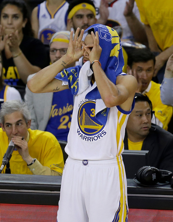 . Golden State Warriors guard Stephen Curry (30) gestures during the second half of Game 1 of basketball\'s NBA Finals against the Cleveland Cavaliers in Oakland, Calif., Thursday, June 1, 2017. (AP Photo/Ben Margot)