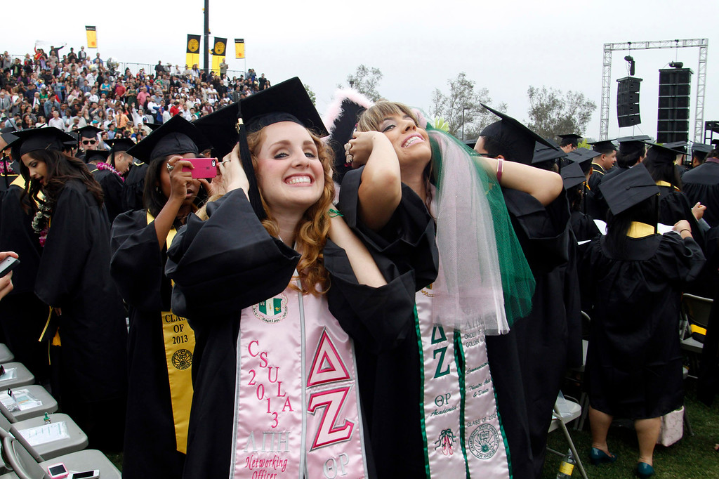 . Megan Ryan, 22, left, and Brittany Rios, 22, both of Los Angeles, during the California State University, Los Angeles, Sixty-Sixth Graduate and Undergraduate Commencement Ceremony, at California State University Athletic Stadium, in Los Angeles, Saturday, June 15, 2013. (Correspondent Photo by James Carbone/SXCITY)