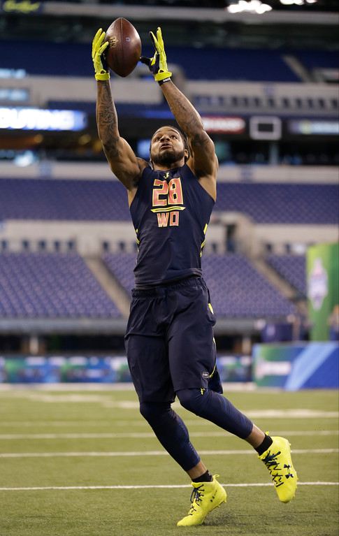 . Akron wide receiver Jerome Lane runs a drill at the NFL football scouting combine in Indianapolis, Saturday, March 4, 2017. (AP Photo/Michael Conroy)