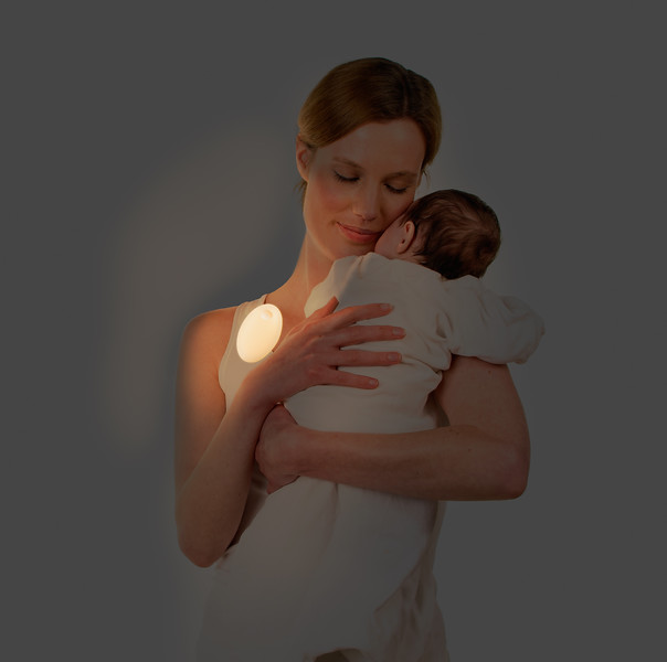 Adult woman holding baby in her arms