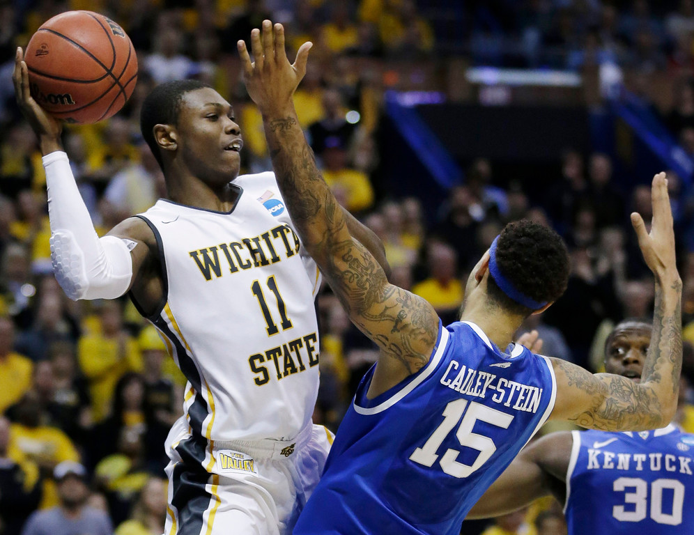 . Wichita State forward Cleanthony Early (11) looks to pass over Kentucky forward Willie Cauley-Stein (15) during the second half of a third-round game of the NCAA college basketball tournament Sunday, March 23, 2014, in St. Louis. (AP Photo/Jeff Roberson)