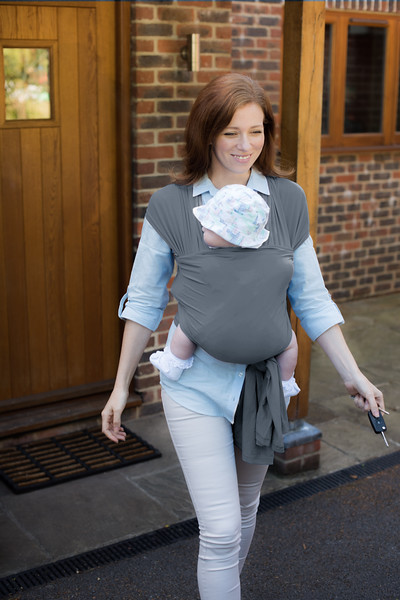 Izmi_Wrap_Lifestyle_Mid_Grey_Front_Carry_Walking_Out_Of_Door.jpg