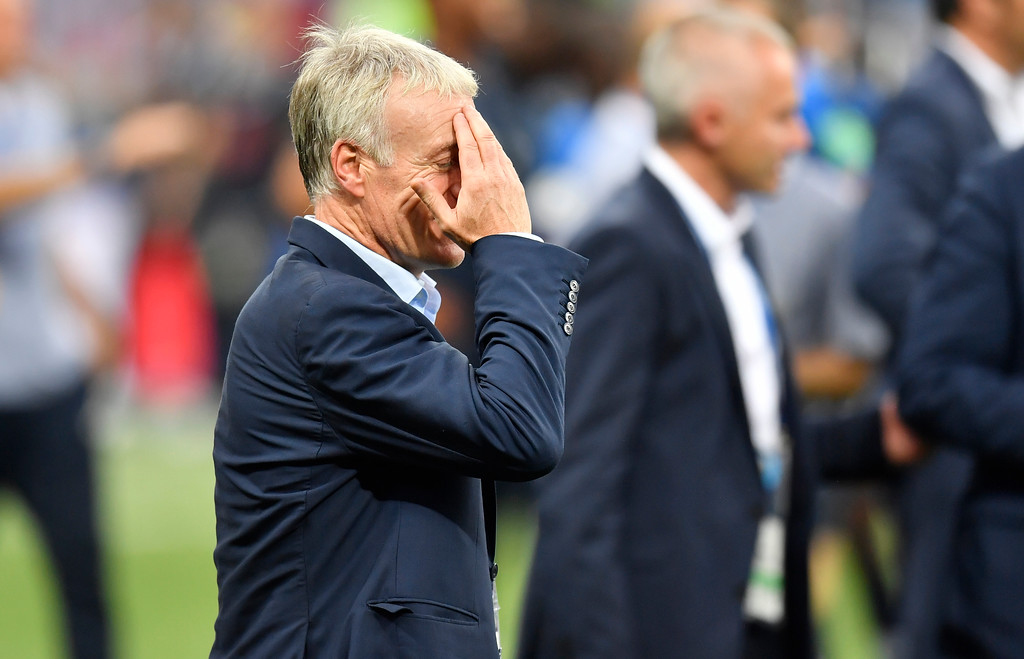 . France head coach Didier Deschamps touches his forehead after his team won 4-2 during the final match between France and Croatia at the 2018 soccer World Cup in the Luzhniki Stadium in Moscow, Russia, Sunday, July 15, 2018. (AP Photo/Martin Meissner)