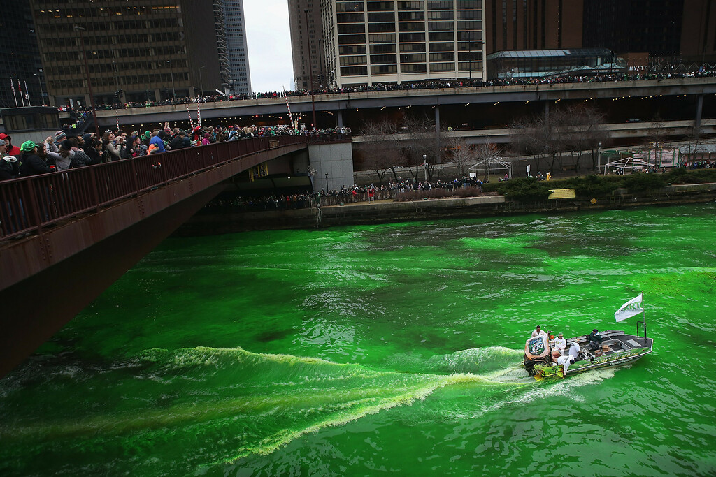 . Workers dye the Chicago River green to kick off the city\'s St. Patrick\'s day celebration on March 16, 2013 in Chicago, Illinois. The dying of the river has been a tradition in the city for 43 years.  (Photo by Scott Olson/Getty Images)