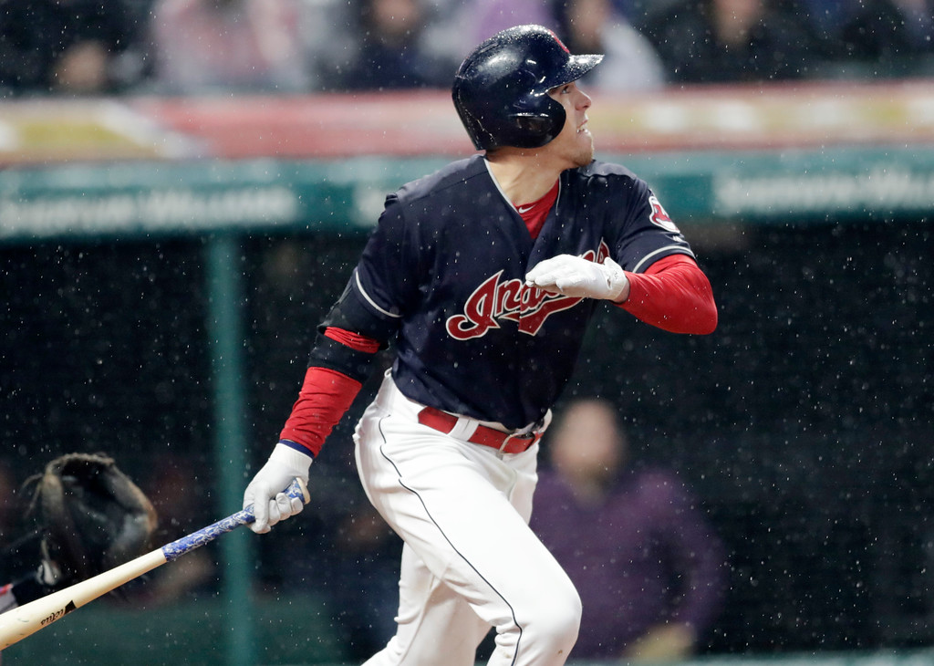 . Cleveland Indians\' Bradley Zimmer hits a double off Chicago Cubs relief pitcher Steve Cishek in the seventh inning of a baseball game, Tuesday, April 24, 2018, in Cleveland. (AP Photo/Tony Dejak)