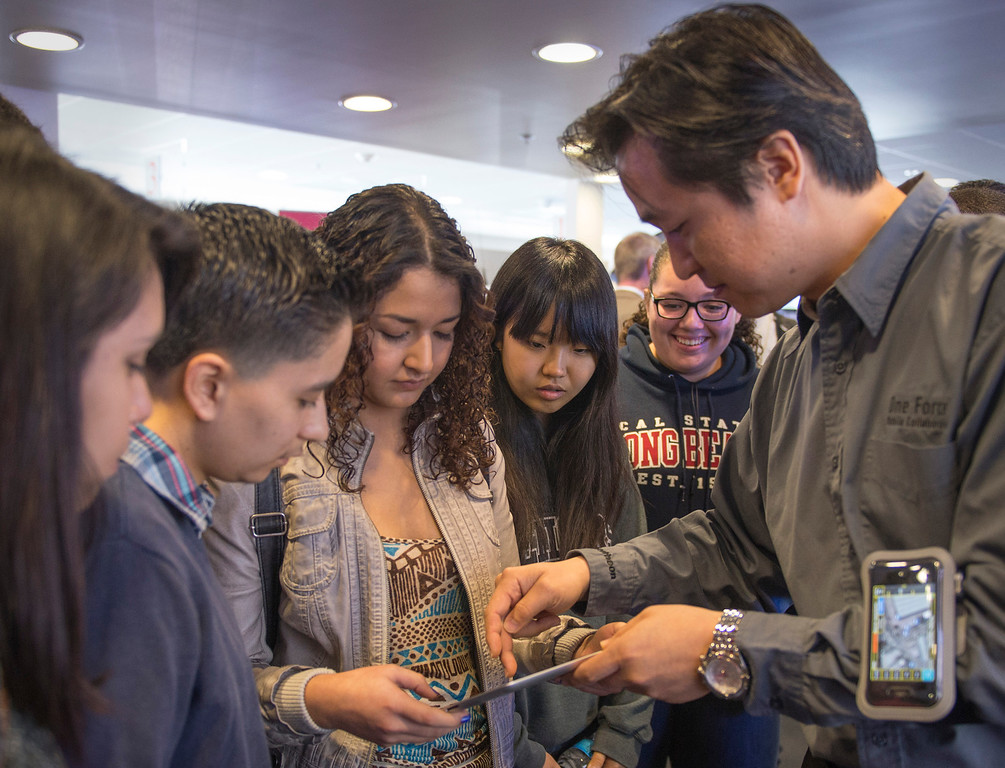 . Raytheon software engineer Mike Cho, left, demonstrates mapping software to Warren High School students during their visit to Raytheon\'s Public Safety Facility in Downey to see the company\'s electronic communications equipment March 6, 2013.  (SGVN/Staff photo by Leo Jarzomb)