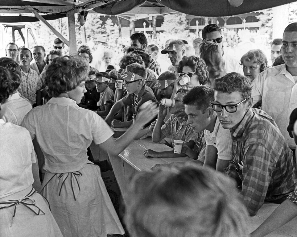 . A busy moment captured at the All the Milk You Can Drink for a Dime booth at the Minnesota State Fair, 1962. Photo courtesy of the Minnesota State Fair.