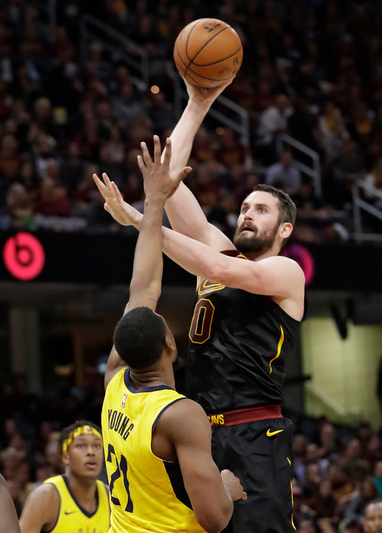 . Cleveland Cavaliers\' Kevin Love (0) shoots over Indiana Pacers\' Thaddeus Young (21) in the first half of Game 5 of an NBA basketball first-round playoff series, Wednesday, April 25, 2018, in Cleveland. (AP Photo/Tony Dejak)