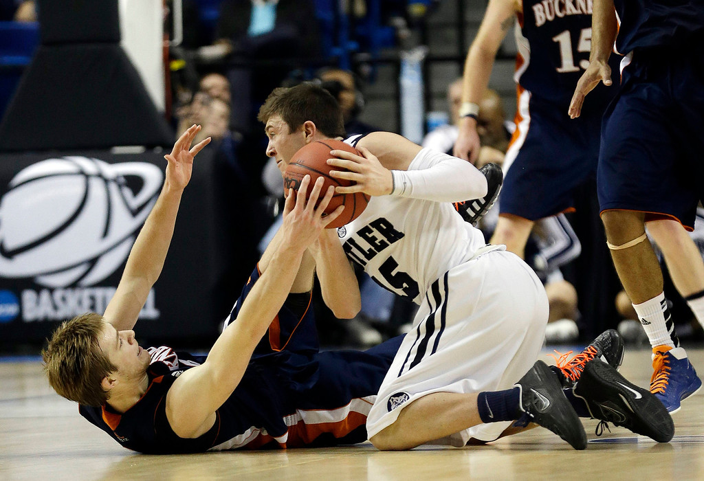 . Butler guard Rotnei Clarke (15) comes up with a loose ball against Bucknell guard Steven Kaspar (3) during the second half of their second-round game in the  NCAA college basketball tournament Thursday, March 21, 2013, in Lexington, Ky. Butler won  (AP Photo/John Bazemore