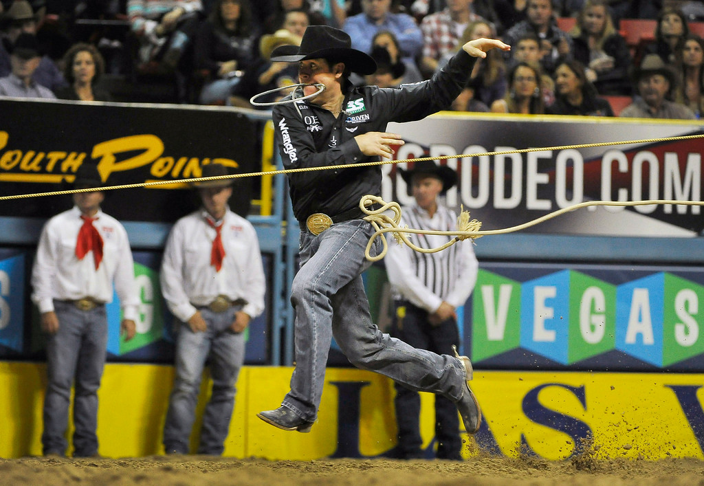 . Trevor Brazile of Decatur, Texas competes in the tie-down roping during the third go-round of the Wrangler National Finals Rodeo on Saturday, Dec. 6, 2014, in Las Vegas. (AP Photo/Las Vegas Review Journal, David Becker)
