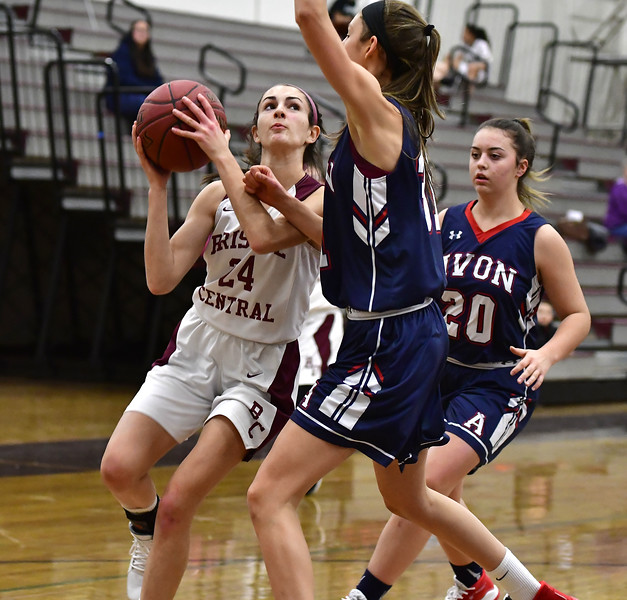 12/20/2019 Mike Orazzi   Staff Bristol Central's Sophia Torreso (24) and Avon's Abigail St. Onge (31) during Friday night's girls basketball game in Bristol.