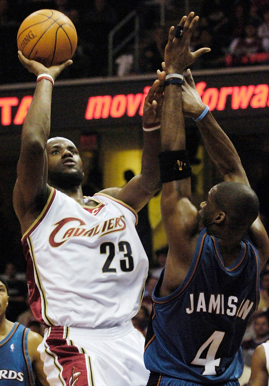 . Michael Blair/MBlair@News-Herald.com Lebron James his a basket over Antawn Jamison during the first period of Wednesday night\'s game.
