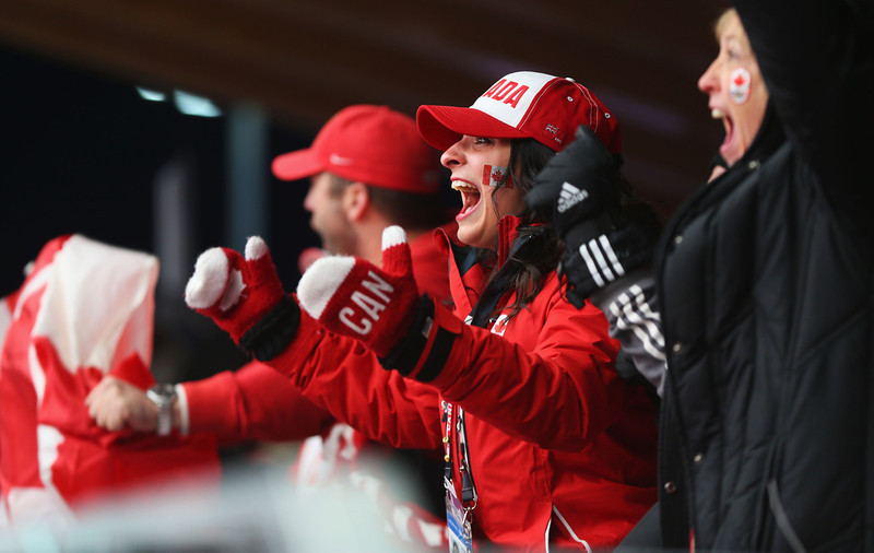 . Canada fans celebrate during the Men\'s Skeleton on Day 8 of the Sochi 2014 Winter Olympics at Sliding Center Sanki on February 15, 2014 in Sochi, Russia.  (Photo by Mike Ehrmann/Getty Images)