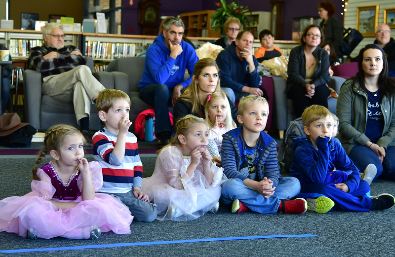 11/10/2018 Mike Orazzi | Staff Children and parents listen to a presentation by Christine's Critters during a Renaissance Faire held at the Southington Public Library Saturday.