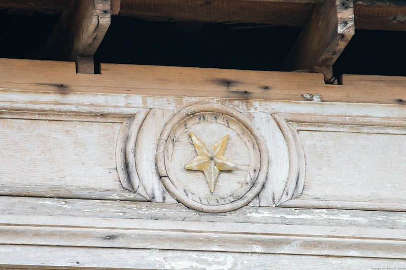 The star on the front door portico.