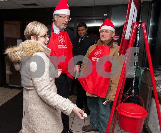 12/04/17 Wesley Bunnell | Staff Representative William Petit Jr., 2nd L, and State Senator Henri Martin, R, share a laugh with Nicole Palmieri as she donates to the Salvation Army at Gnazzo's Food Center in Plainville on Monday evening as Lt. Emmanuel Echavarria, rear, looks on. Representative Petit and Senator Martin volunteered as bell ringers for the evening.