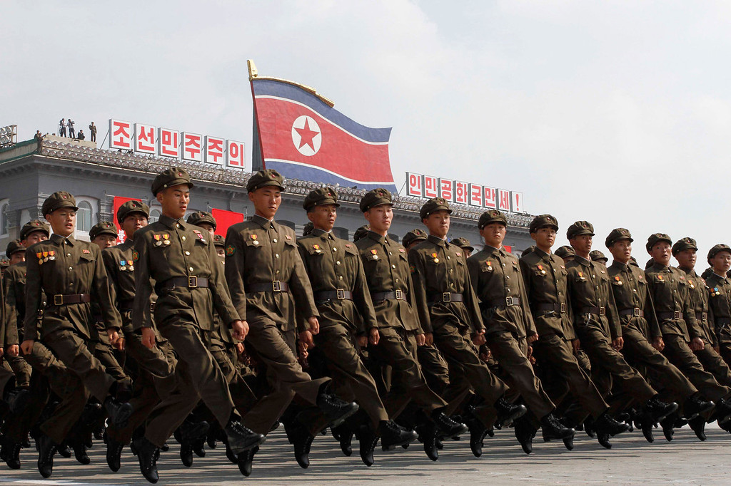 . North Korean troops march during a military parade at Kim Il Sung Square to mark the 65th anniversary of the country\'s founding in Pyongyang, North Korea, Monday, Sept. 9, 2013. (AP Photo/Kim Kwang Hyon)