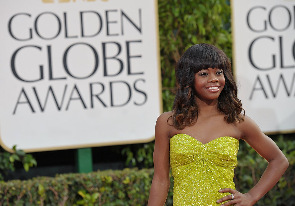 Description of . Olympic gymnast Gabby Douglas  arrives at the 70th Annual Golden Globe Awards at the Beverly Hilton Hotel on Sunday Jan. 13, 2013, in Beverly Hills, Calif. (Photo by John Shearer/Invision/AP)