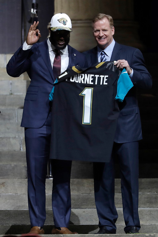 . LSU\'s Leonard Fournette, left, poses with NFL commissioner Roger Goodell after being selected by the Jacksonville Jaguars during the first round of the 2017 NFL football draft, Thursday, April 27, 2017, in Philadelphia. (AP Photo/Julio Cortez)