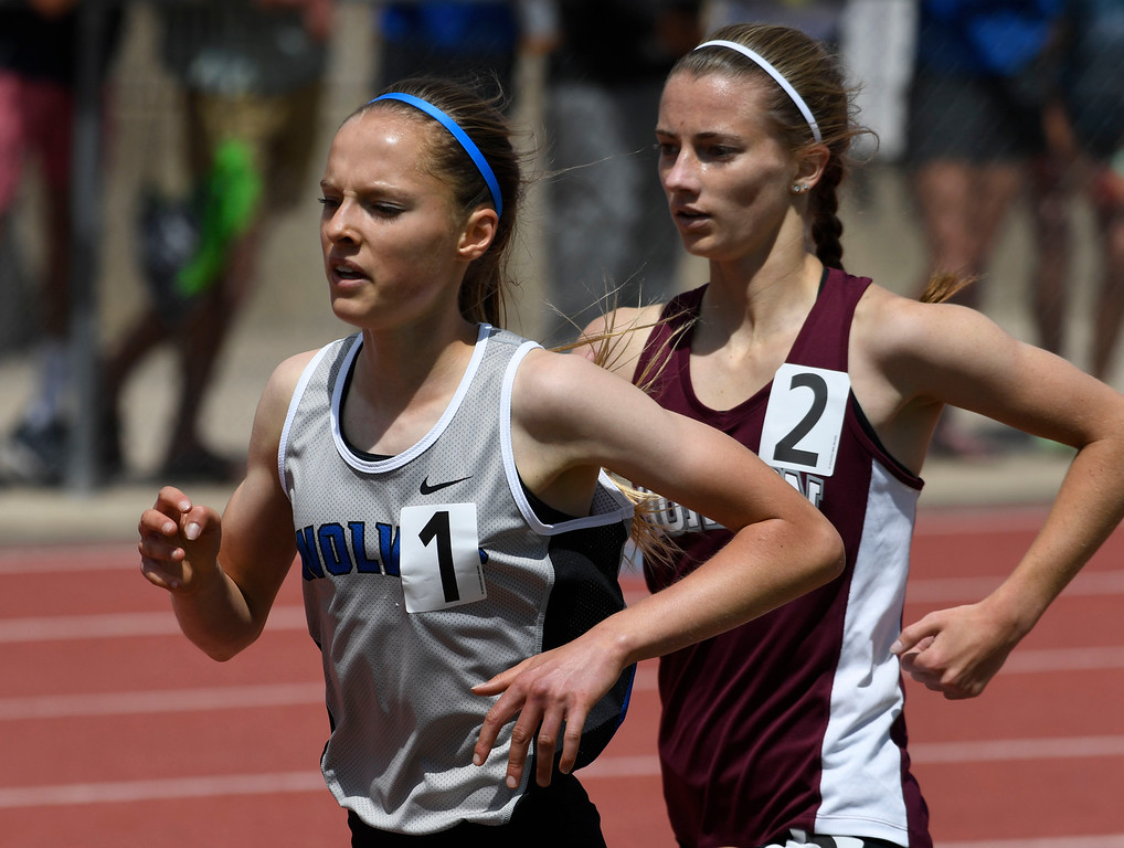 . Brie Oakley, Grandview, right, and Madison Mooney, Horizon, race close together during the girls 1600 meter run final at the Colorado Track and Field State Championships at Jeffco Stadium May 21, 2016. Mooney clipped Oakley moments later, causing her to fall, Mooney crossed the finish line first, but was later disqualified, giving the victory to Oakley. (Photo by Andy Cross/The Denver Post)