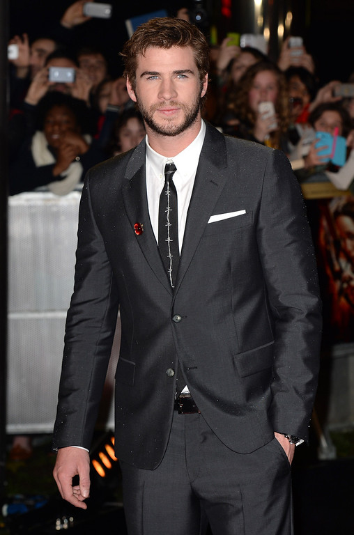 ". Liam Hemsworth attends the UK Premiere of ""The Hunger Games: Catching Fire\"" at Odeon Leicester Square on November 11, 2013 in London, England. (Photo by Zak Hussein/Getty Images)"
