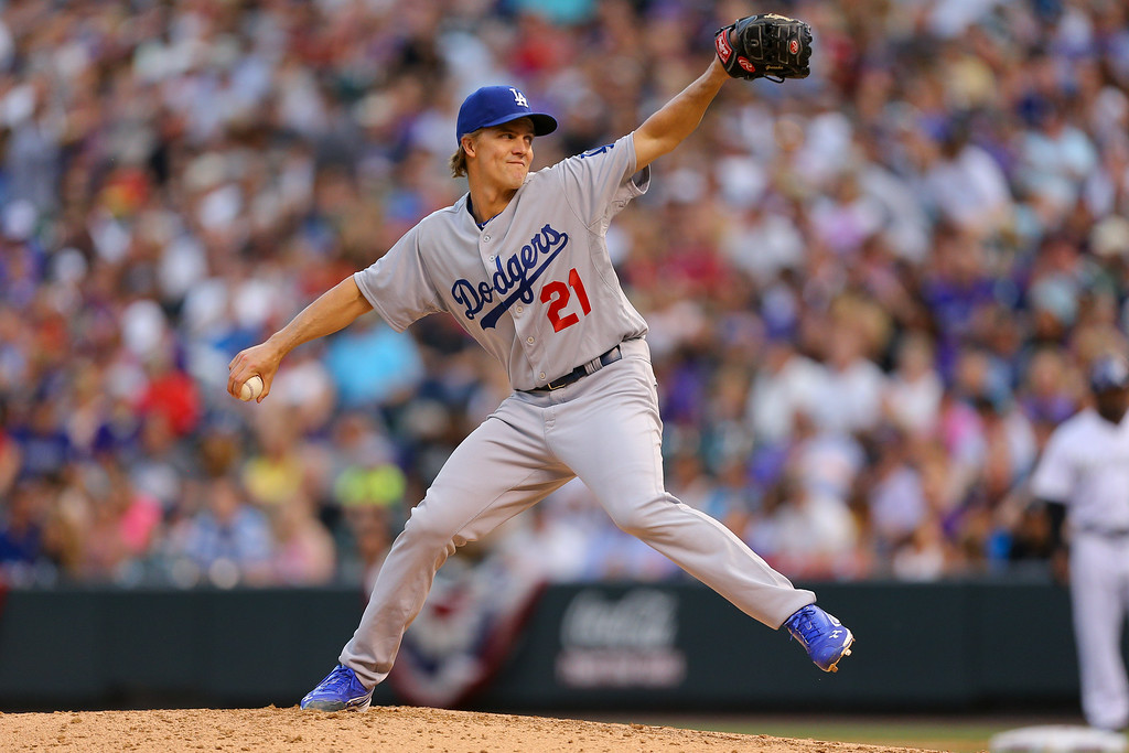. Starting pitcher Zack Greinke #21 of the Los Angeles Dodgers delivers to home plate during the fifth inning against the Colorado Rockies at Coors Field on July 3, 2014 in Denver, Colorado.  (Photo by Justin Edmonds/Getty Images)