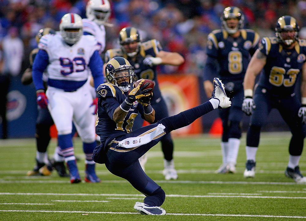 . Austin Pettis #18 of the St. Louis Rams makes a crucial catch on 4th Down and 1 yard to go to keep the St Louis drive going against the Buffalo Bills at Ralph Wilson Stadium on December 9, 2012 in Orchard Park, New York.St Louis later scored the game winning touchdown on the drive.St Louis won 15-12.  (Photo by Rick Stewart/Getty Images)