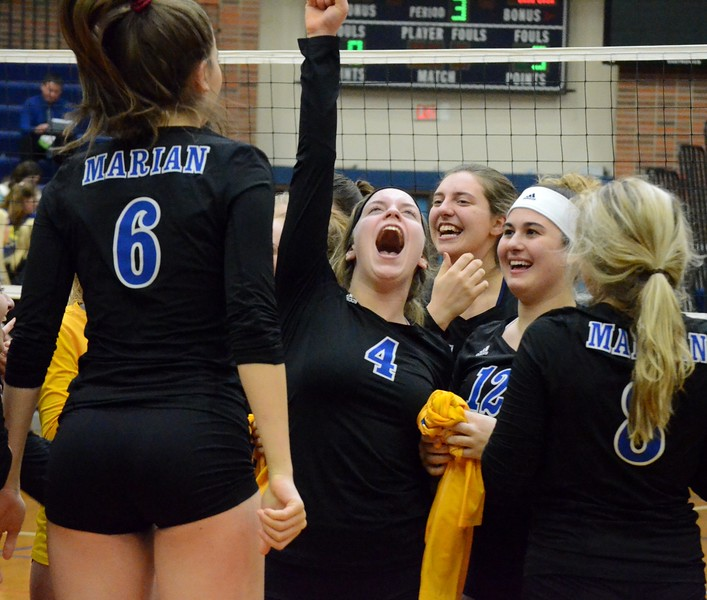 Birmingam Marian advanced to the Class A semifinals on Tuesday thanks to a 25-22, 25-10, 25-21 win over Midland in the quarterfinals at Saginaw Heritage High School. (Oakland Press photo gallery by Drew Ellis)