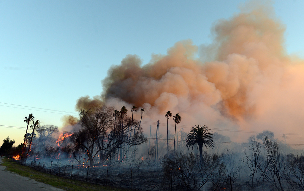 . Over 20 acres have burned in the area next to the Louis Robidoux Nature Center in the Jurupa Valley on Feb. 28, 2013. (Will Lester/Inland Valley Daily Bulletin)